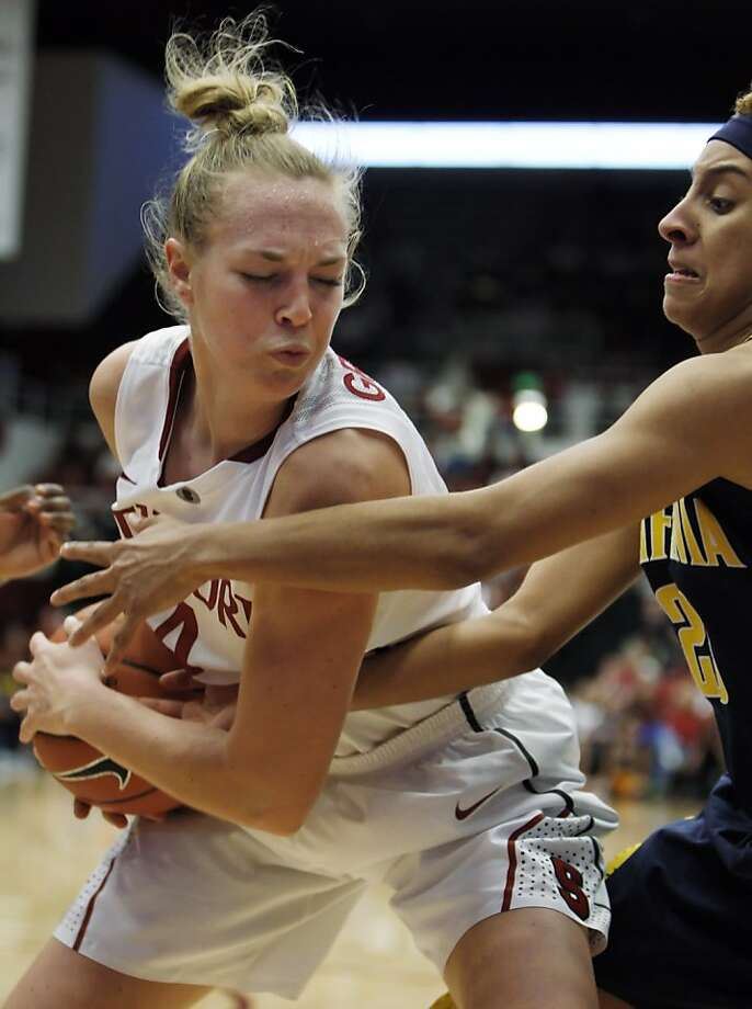 Stanford's Taylor Greenfield, left, fights for a rebound against Cal's Layshia Clarendon in the second half. Stanford women played Cal at Maples Pavilion in Stanford, Calif., on Sunday, January 13, 2013, with Cal defeating the Cardinal 67-54 Photo: Carlos Avila Gonzalez, The Chronicle