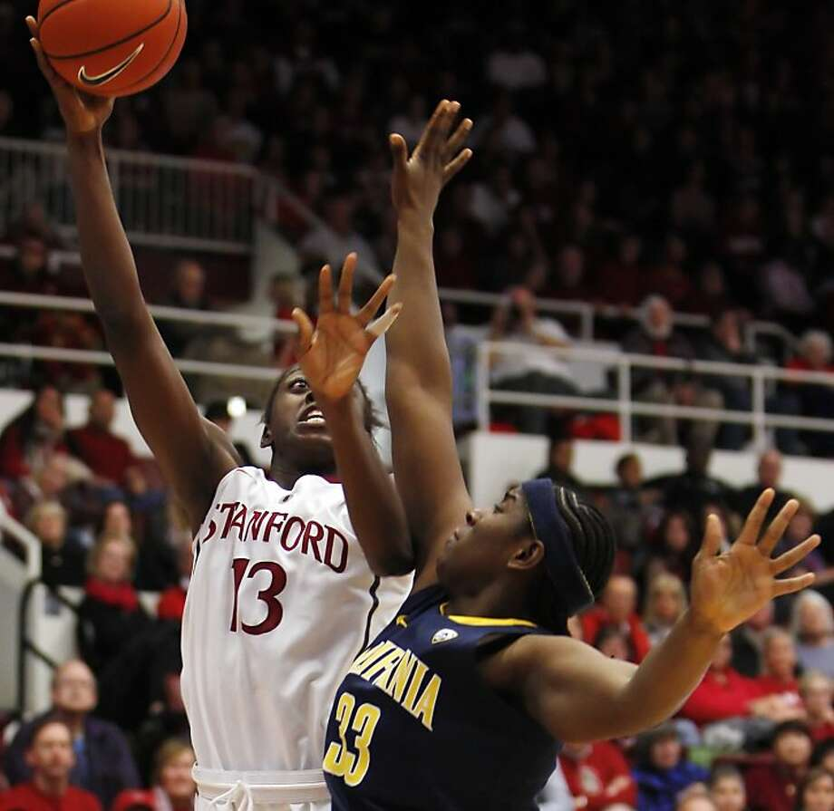 Chiney Ogwumike is defended by Talia Caldwell in the second half. Stanford women played Cal at Maples Pavilion in Stanford, Calif., on Sunday, January 13, 2013, with Cal defeating the Cardinal 67-54 Photo: Carlos Avila Gonzalez, The Chronicle