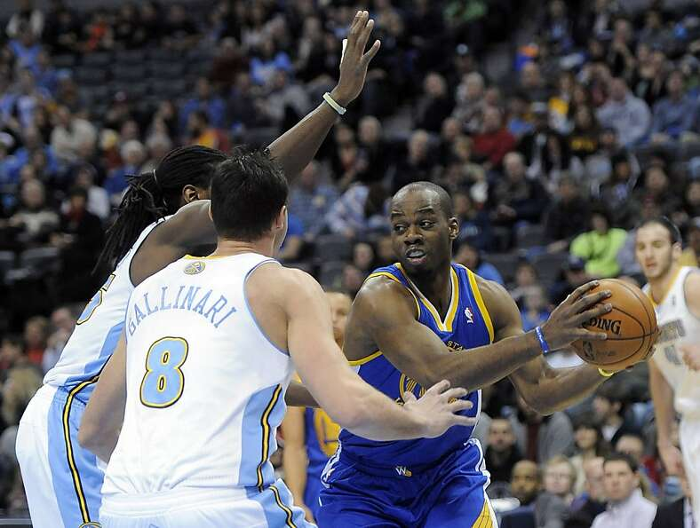 Golden State Warriors forward Carl Landry, right, is defended by Denver Nuggets forward Kenneth Fari
