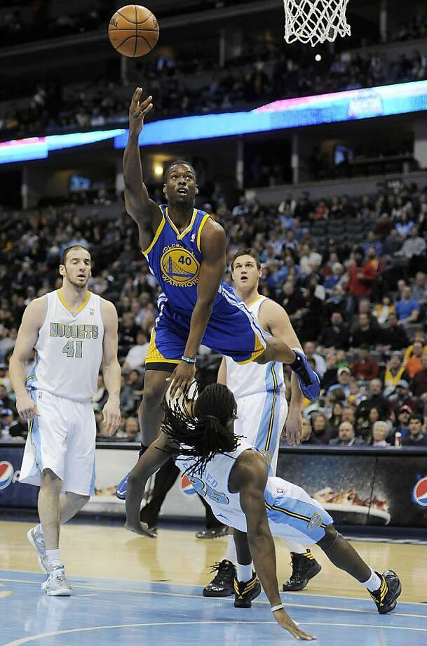 Golden State Warriors forward Harrison Barnes, top, knocks over Denver Nuggets forward Kenneth Faried, bottom, for an offensive foul in the first quarter of an NBA basketball game on Sunday, Jan. 13, 2013, in Denver. Denver center Kosta Koufos, rear left, and forward Danilo Gallinari, of Italy, rear right, watch the play unfold. (AP Photo/Chris Schneider) Photo: Chris Schneider, Associated Press