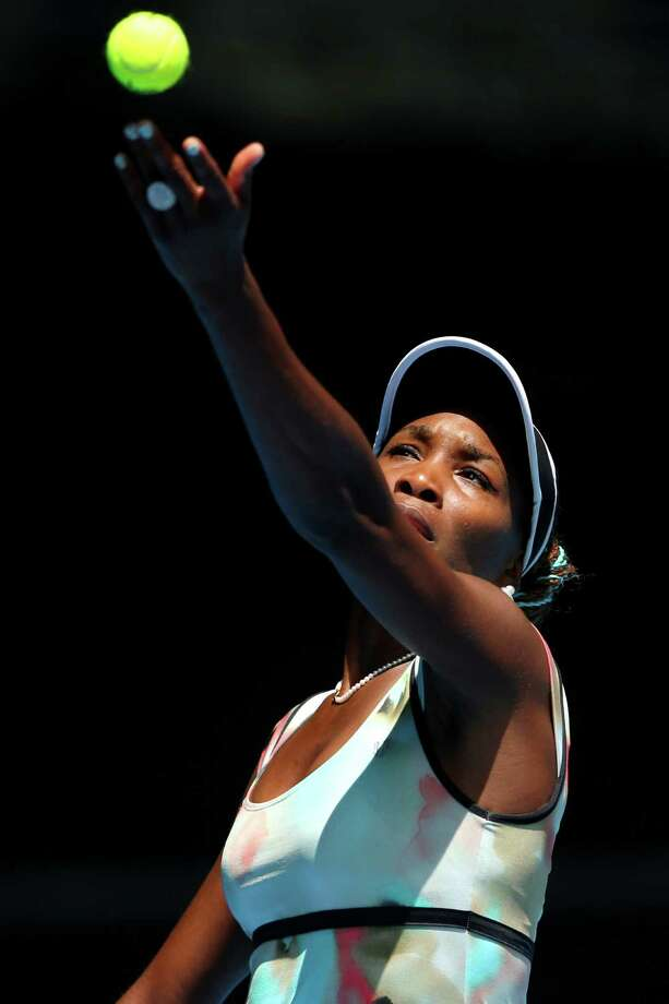 MELBOURNE, AUSTRALIA - JANUARY 14:  Venus Williams of the United States serves in her first round match against Galina Voskoboeva of Kazakhstan during day one of the 2013 Australian Open at Melbourne Park on January 14, 2013 in Melbourne, Australia.  (Photo by Julian Finney/Getty Images) Photo: Julian Finney