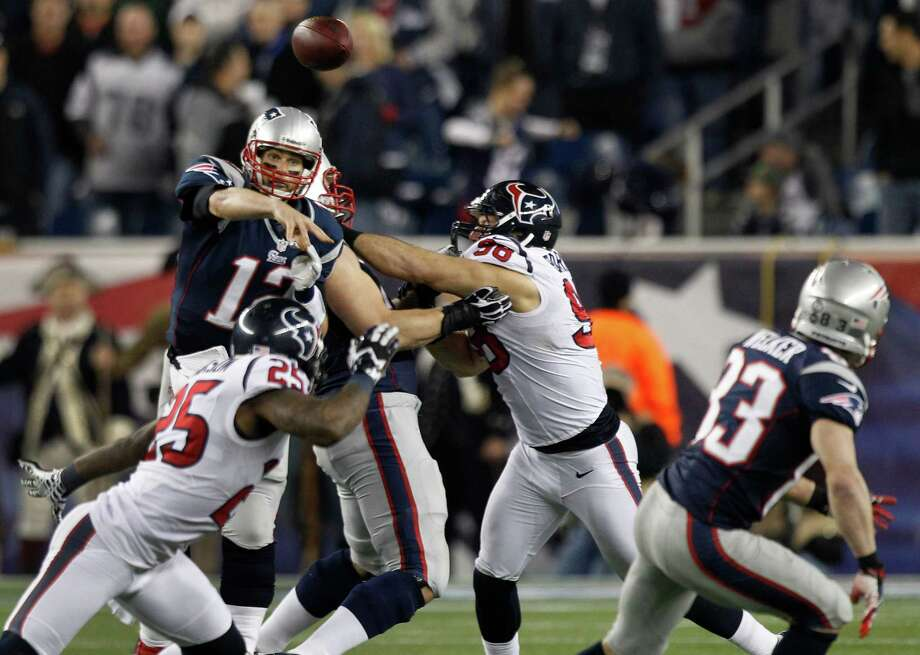 Patriots quarterback Tom Brady (12) throws a pass to wide receiver Wes Welker (83) as he is pressured by Texans outside linebacker Connor Barwin (98) during the third quarter. Photo: Brett Coomer, Houston Chronicle / © 2013  Houston Chronicle