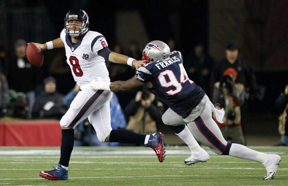 exans quarterback Matt Schaub (8) is forced out of the pocket by Patriots defensive end Justin Francis (94) during the third quarter. Photo: Brett Coomer, Houston Chronicle / © 2013  Houston Chronicle