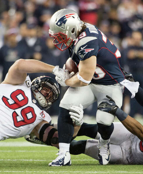 Texans defensive end J.J. Watt (99) makes a stop on Patriots running back Danny Woodhead (39) during