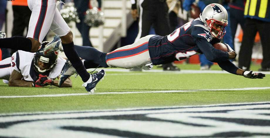 Patriots wide receiver Brandon Lloyd (85) dives for a touchdown past Johnathan Joseph (24) during the third quarter. Photo: Smiley N. Pool, Houston Chronicle / © 2013  Houston Chronicle