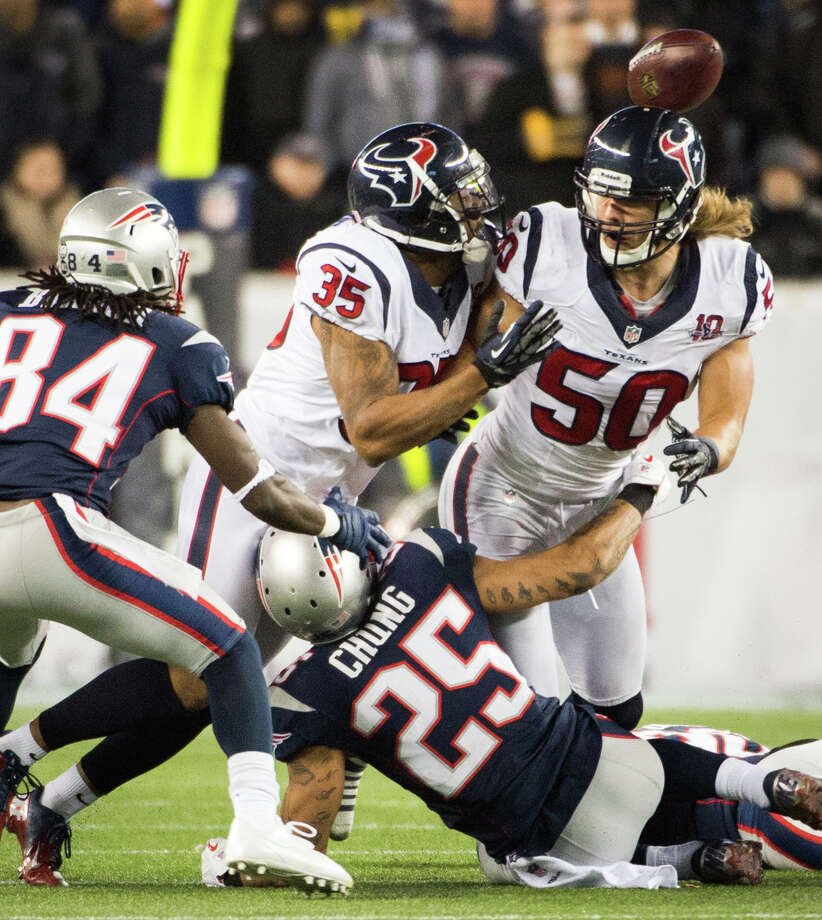 Texans safety Eddie Pleasant (35) and linebacker Bryan Braman (50) can't come up with an onside kick during the fourth quarter. Photo: Smiley N. Pool, Houston Chronicle / © 2013  Houston Chronicle