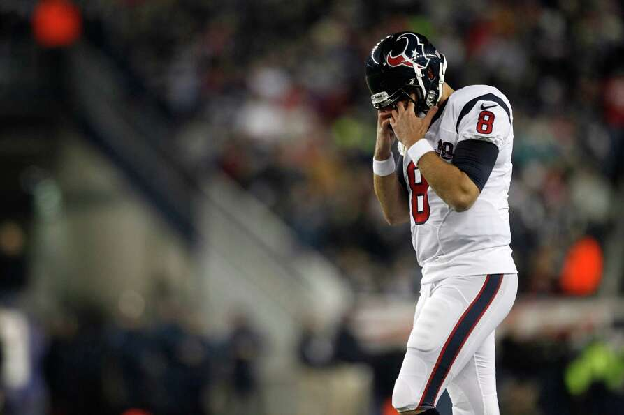 Texans quarterback Matt Schaub walks back to the field against.