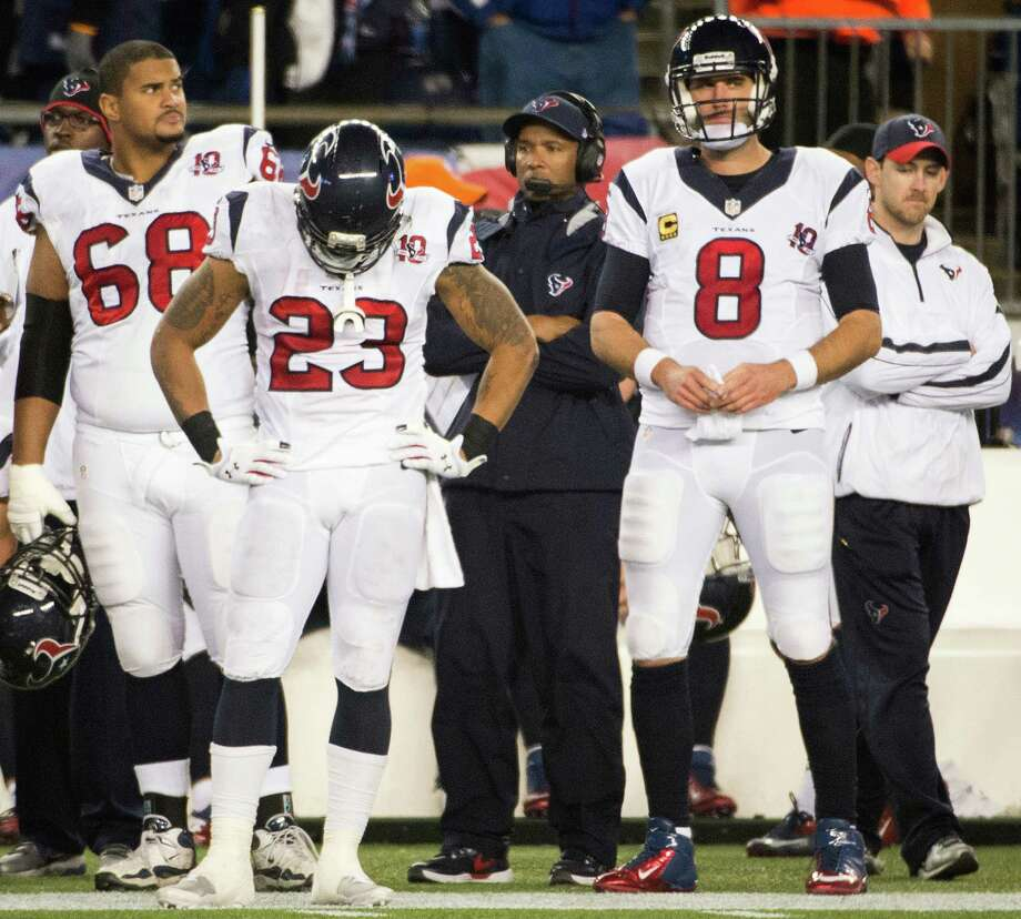 Texans quarterback Matt Schaub (8), running back Arian Foster (23), tackle Ryan Harris (68) and wide receiver Kevin Walter (83) stand on the bench after a New England Patriots touchdown during the fourth quarter. Photo: Smiley N. Pool, Houston Chronicle / © 2013  Houston Chronicle