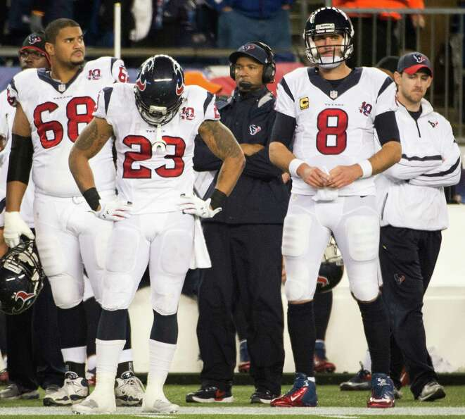 Texans quarterback Matt Schaub (8), running back Arian Foster (23), tackle Ryan Harris (68) and wide