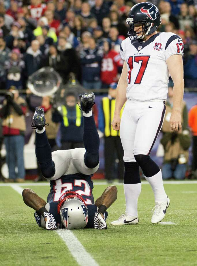 Texans kicker Shayne Graham (17) looks down as  Patriots cornerback Kyle Arrington (24) lands at his feet after Graham kicked a 27-yard field goal on the opening drive. Photo: Smiley N. Pool, Houston Chronicle / © 2013  Houston Chronicle