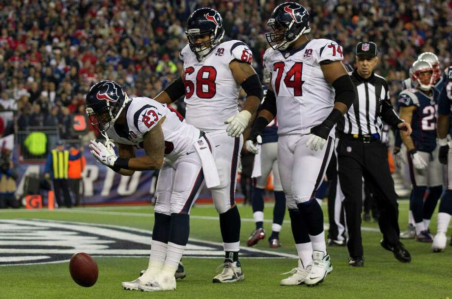 Texans running back Arian Foster (23) celebrates after scoring on a touchdown run during the second quarter. Photo: Brett Coomer, Houston Chronicle / © 2013  Houston Chronicle
