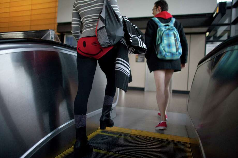 Participants enter Sea-Tac Airport during Emerald City Improv's No Pants Light Rail Ride on Sunday, January 13, 2013. Dozens of participants took off their pants while riding on the train, shocking some other passengers. Photo: JOSHUA TRUJILLO, SEATTLEPI.COM / SEATTLEPI.COM