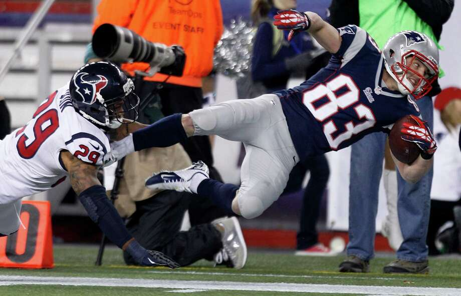 Patriots wide receiver Wes Welker (83) is pushed out of bounds inside the 10-yard-line by Texans strong safety Glover Quin (29) during the second quarter. Photo: Brett Coomer, Houston Chronicle / © 2013  Houston Chronicle
