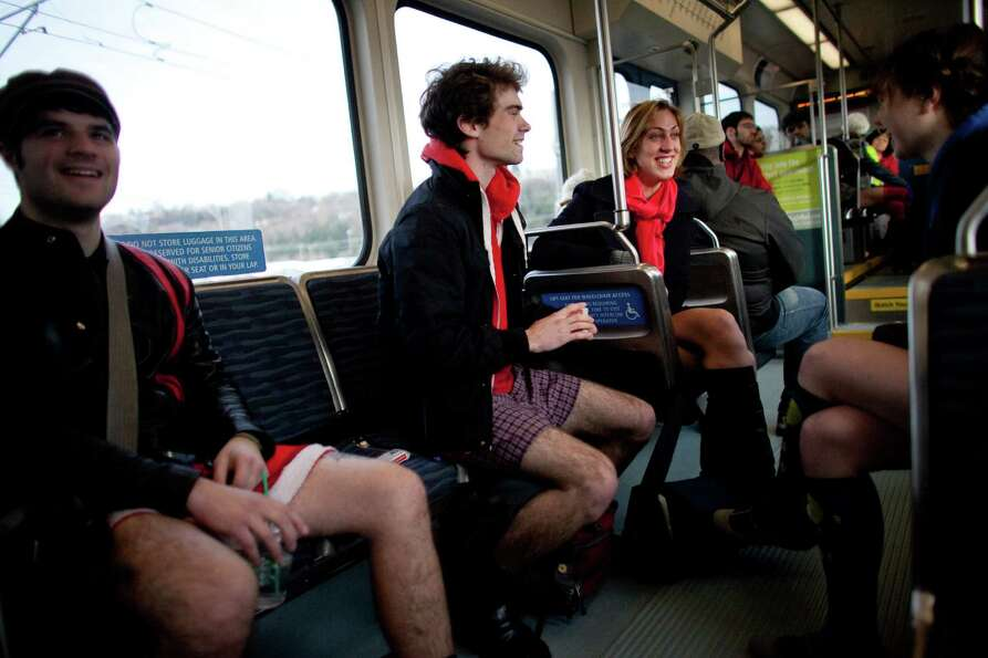 Participants ride the rail during Emerald City Improv's No Pants Light Rail Ride on Sunday, January