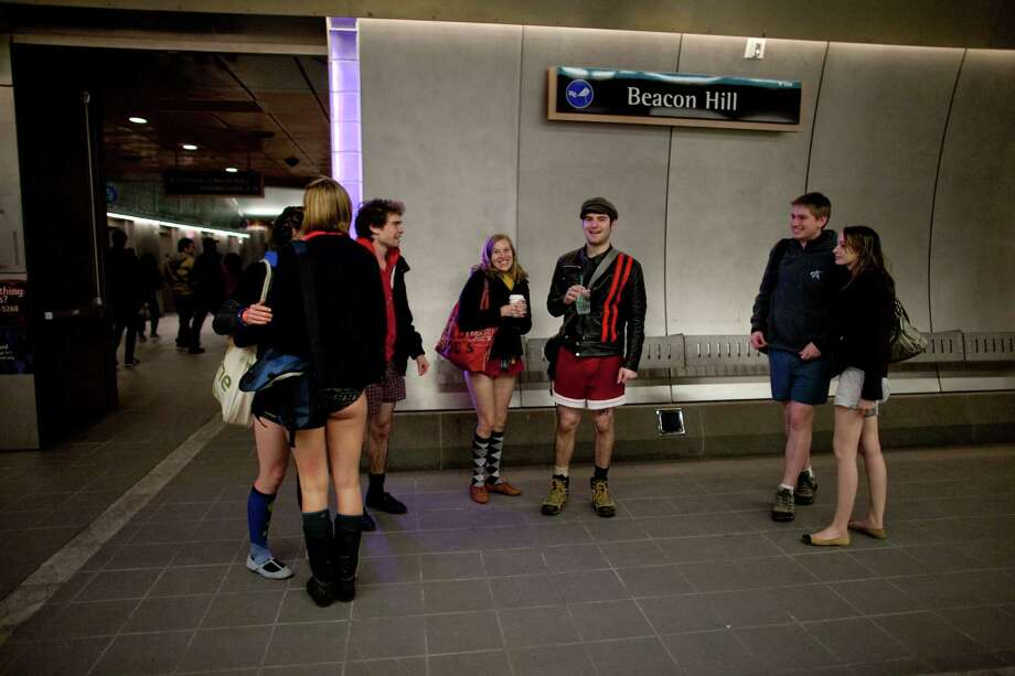 Participants gather at the Beacon Hill station during Emerald City Improv's No Pants Light Rail Ride on Sunday, January 13, 2013. Dozens of participants took off their pants while riding on the train, shocking some other passengers. Photo: JOSHUA TRUJILLO, SEATTLEPI.COM / SEATTLEPI.COM