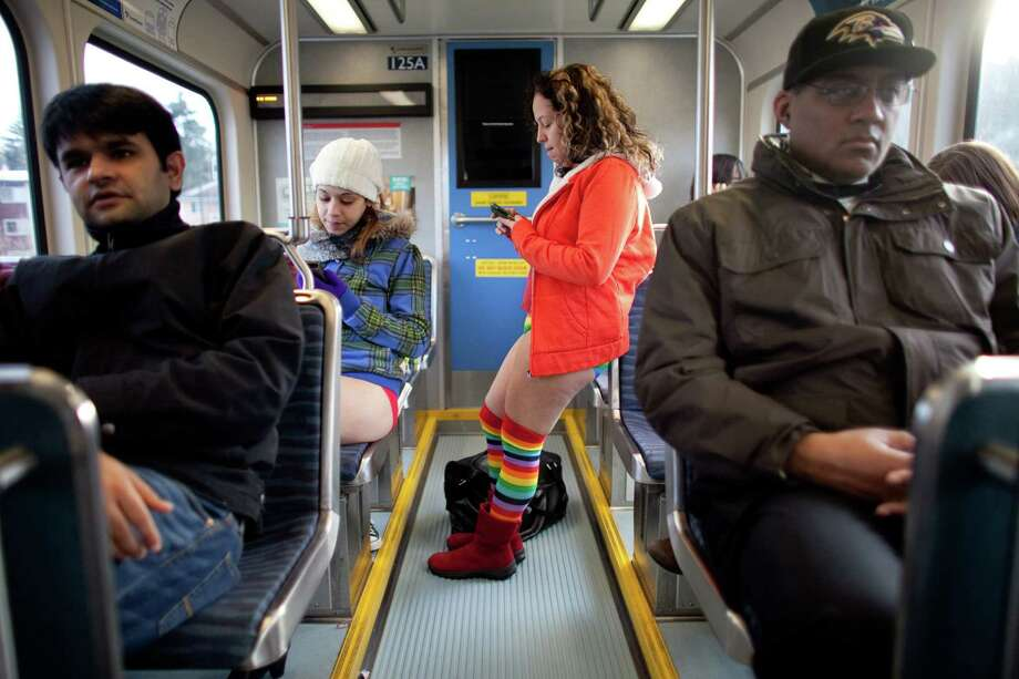 Participants ride the rail during Emerald City Improv's No Pants Light Rail Ride on Sunday, January 13, 2013. Dozens of participants took off their pants while riding on the train, shocking some other passengers. Photo: JOSHUA TRUJILLO, SEATTLEPI.COM / SEATTLEPI.COM