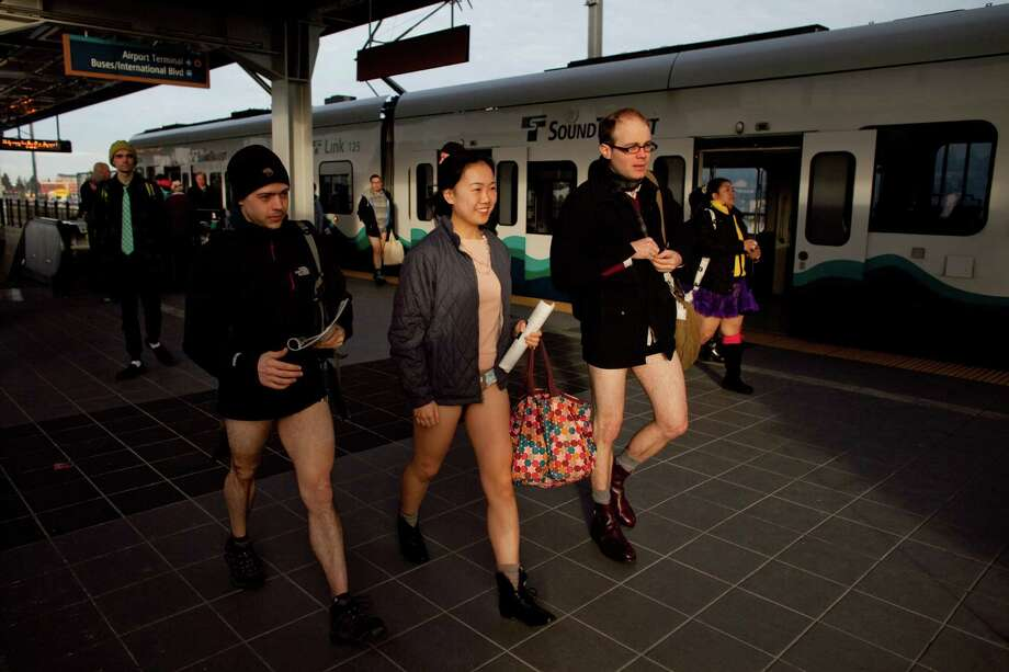 People exit the train during Emerald City Improv's No Pants Light Rail Ride on Sunday, January 13, 2013. Dozens of participants took off their pants while riding on the train, shocking some other passengers. Photo: JOSHUA TRUJILLO, SEATTLEPI.COM / SEATTLEPI.COM
