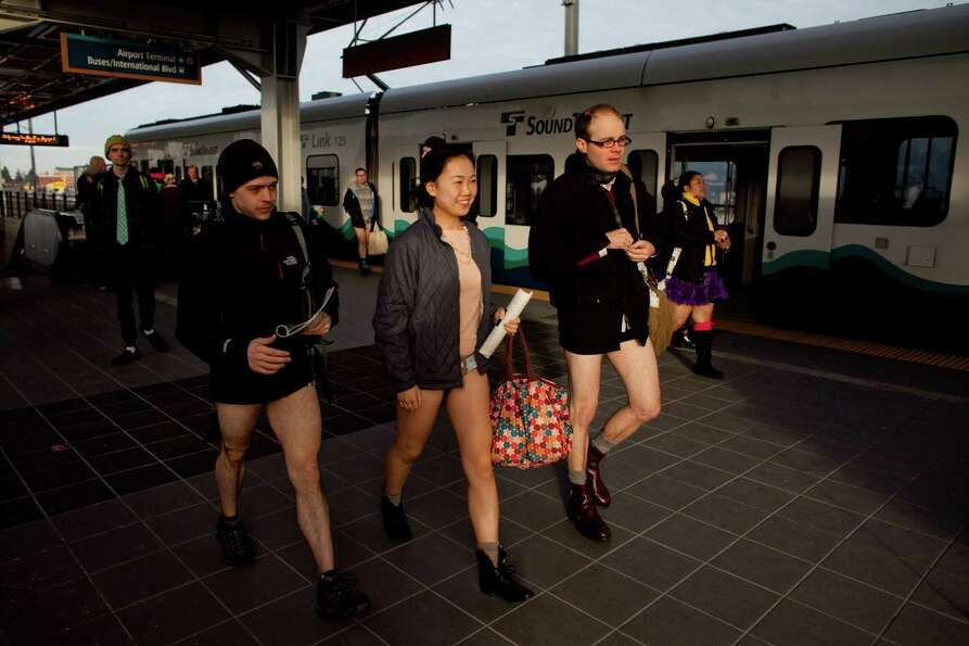 People exit the train during Emerald City Improv's No Pants Light Rail Ride on Sunday, January 13, 2