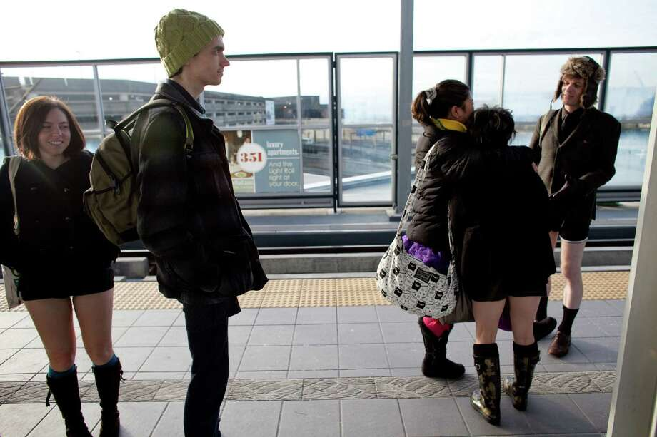 People gather at the Sea-Tac station during Emerald City Improv's No Pants Light Rail Ride on Sunday, January 13, 2013. Dozens of participants took off their pants while riding on the train, shocking some other passengers. Photo: JOSHUA TRUJILLO, SEATTLEPI.COM / SEATTLEPI.COM