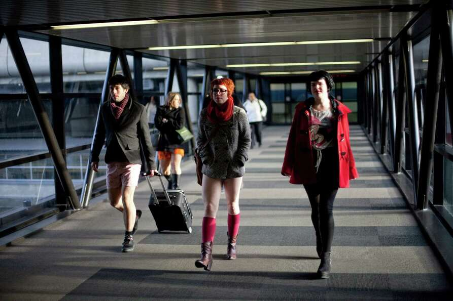 Participants walk into Sea-Tac Airport during Emerald City Improv's No Pants Light Rail Ride on Sund