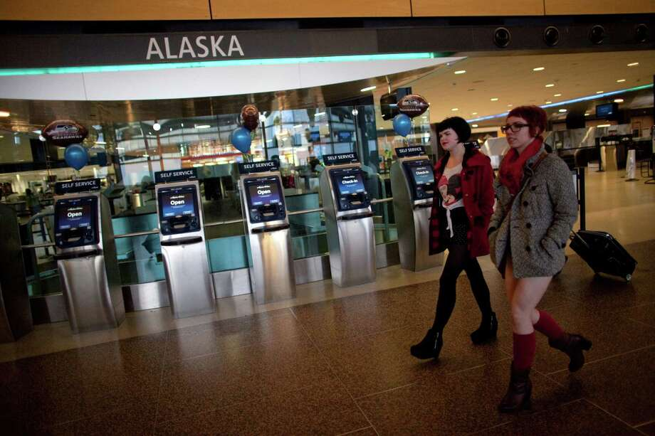 Participants walk through the airport during Emerald City Improv's No Pants Light Rail Ride on Sunday, January 13, 2013. Dozens of participants took off their pants while riding on the train, shocking some other passengers. Photo: JOSHUA TRUJILLO, SEATTLEPI.COM / SEATTLEPI.COM
