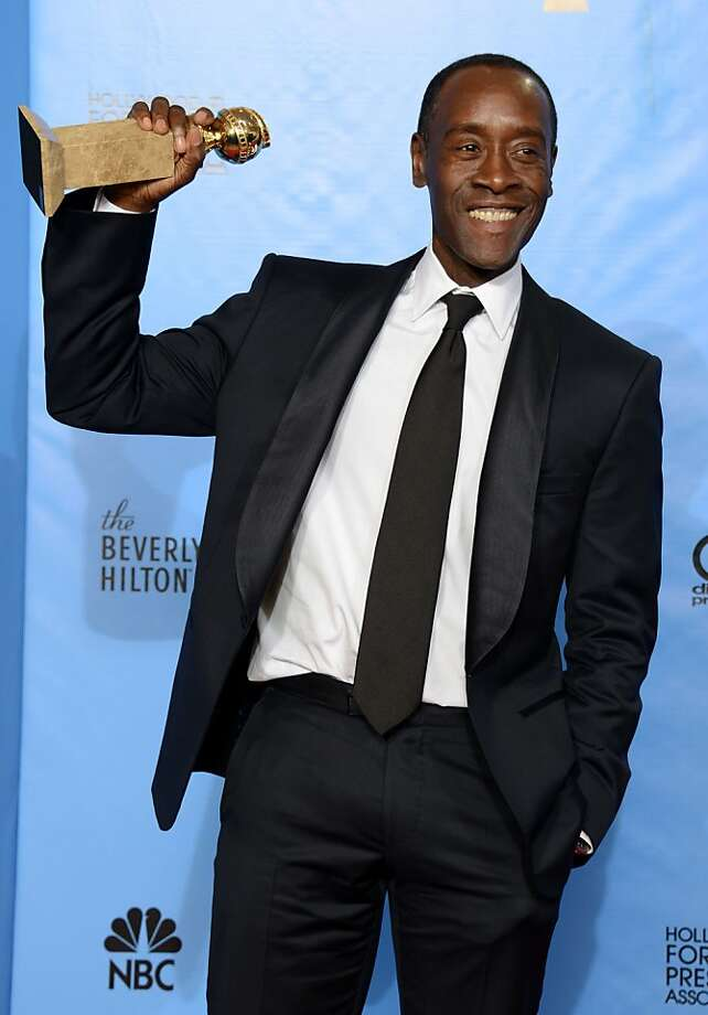 "Actor Don Cheadle poses with the award for best performance by an actor in a television series - comedy or musical for ""House of Lies"" backstage at the 70th Annual Golden Globe Awards at the Beverly Hilton Hotel on Sunday Jan. 13, 2013, in Beverly Hills, Calif. (Photo by Jordan Strauss/Invision/AP) Photo: Jordan Strauss, Associated Press"