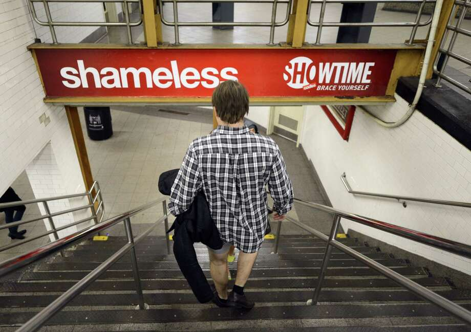 Some riders in the New York City subway in the underwear as the take part in the 2013 No Pants Subway Ride January 13, 2013. Started by Improv Everywhere, the goal is for riders to get on the subway train dressed in normal winter clothes (without pants) and keep a straight face.  AFP PHOTO / TIMOTHY A. CLARYTIMOTHY A. CLARY/AFP/Getty Images Photo: TIMOTHY A. CLARY