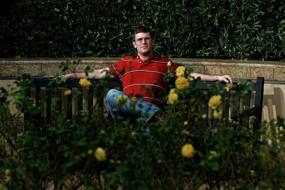 "Austin Sturh relaxes on the grounds of the Palmer Drug Abuse Program. He said he hit rock bottom last February when a homeless person help him gain entry to a crack house. ""It scared the hell out of me,"" he said. Photo: Johnny Hanson, Staff / © 2012  Houston Chronicle"