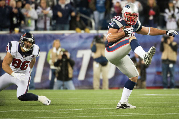 Patriots defensive end Rob Ninkovich (50) intercepts a pass intended for Houston Texans fullback James Casey (86) during the third quarter. Photo: Smiley N. Pool, Houston Chronicle / © 2013  Houston Chronicle