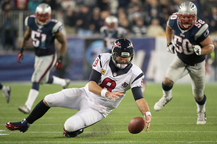 Texans quarterback Matt Schaub falls on his own fumble during the third quarter. Photo: Smiley N. Pool, Houston Chronicle / © 2013  Houston Chronicle