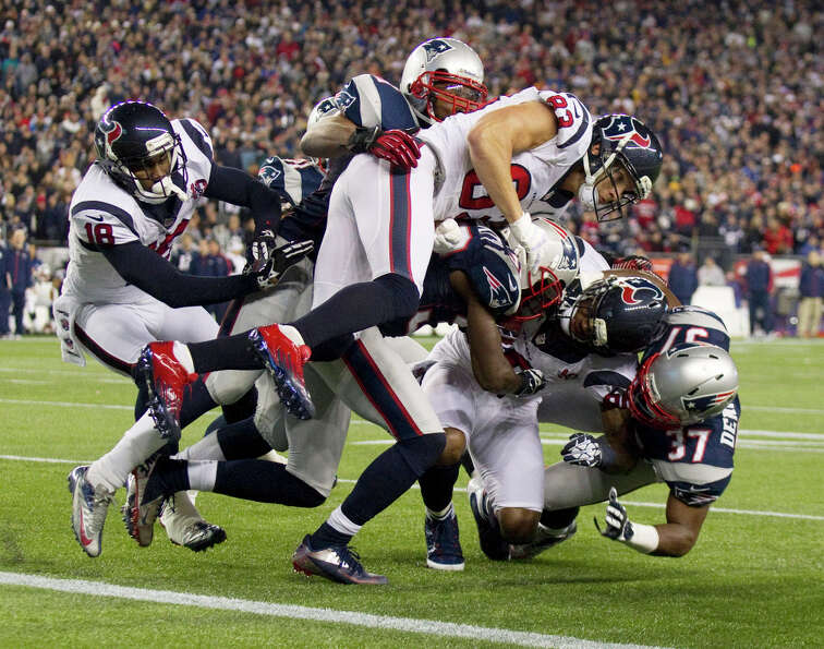 Texans wide receiver Andre Johnson (80) is stuffed by the New England Patriots defense short of the