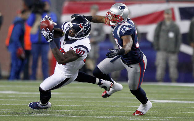 Texans wide receiver Andre Johnson (80) makes a catch as New England Patriots cornerback Aqib Talib (31) defends during the first quarter. Photo: Brett Coomer, Houston Chronicle / © 2013  Houston Chronicle