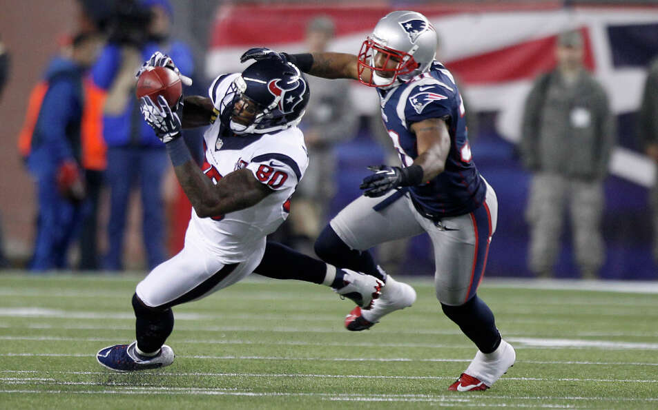 Texans wide receiver Andre Johnson (80) makes a catch as New England Patriots cornerback Aqib Talib
