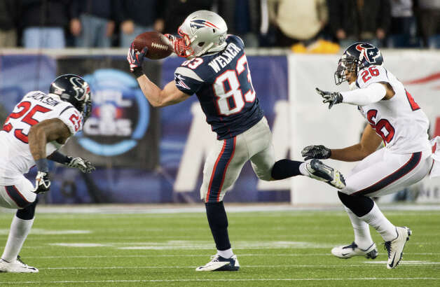 Patriots wide receiver Wes Welker (83) makes a catch between Texans cornerback Kareem Jackson (25) and defensive back Brandon Harris (26) defend during the first quarter. Photo: Smiley N. Pool, Houston Chronicle / © 2013  Houston Chronicle