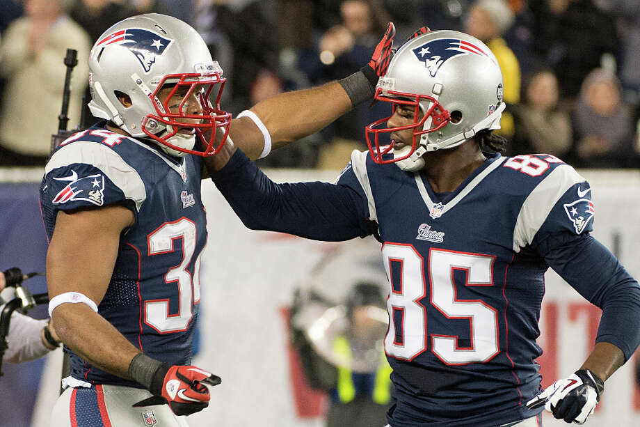 Patriots running back Shane Vereen (34) celebrates with wide receiver Brandon Lloyd (85) after catching a touchdown pass during the second quarter. Photo: Smiley N. Pool, Houston Chronicle / © 2013  Houston Chronicle