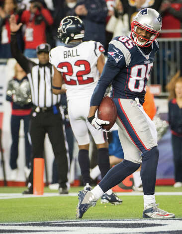 Patriots wide receiver Brandon Lloyd (85) celebrates after scoring past Texans cornerback Alan Ball (22) during the third quarter. Photo: Smiley N. Pool, Houston Chronicle / © 2013  Houston Chronicle