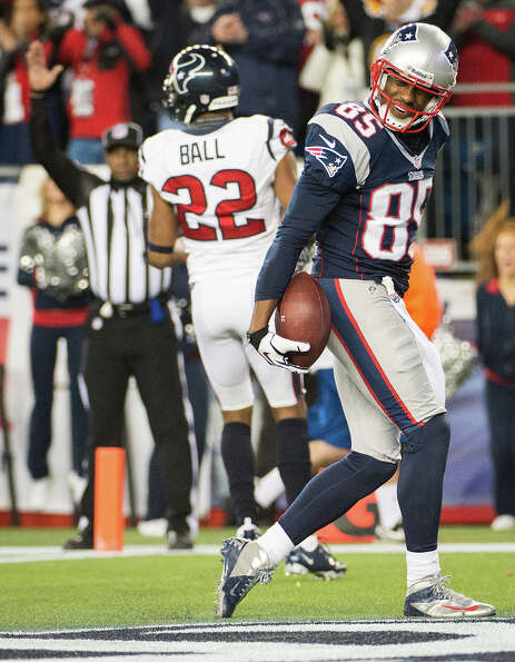 Patriots wide receiver Brandon Lloyd (85) celebrates after scoring past Texans cornerback Alan Ball