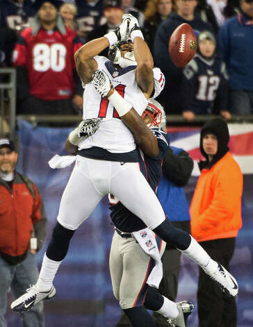 Texans wide receiver DeVier Posey (11) can't hold on to a pass as Patriots cornerback Alfonzo Dennard (37) defends during the fourth quarter. Photo: Smiley N. Pool, Houston Chronicle / © 2013  Houston Chronicle