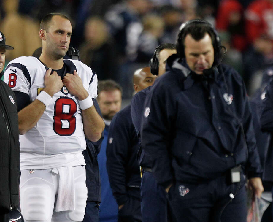 Texans quarterback Matt Schaub stands on the sidelines as head coach Gary Kubiak walks past him during the fourth quarter. Photo: Brett Coomer, Houston Chronicle / © 2013  Houston Chronicle