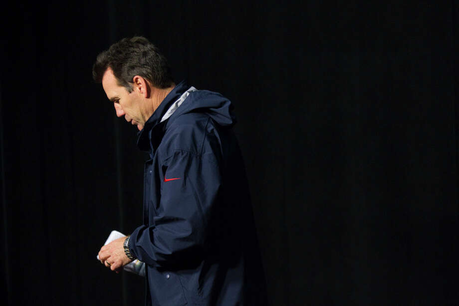 Texans head coach Gary Kubiak walks away from the post-game news conference following the Texans loss. Photo: Brett Coomer, Houston Chronicle / © 2013  Houston Chronicle