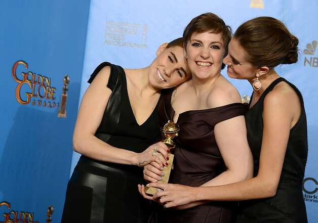 "Zosia Mamet, left, Lena Dunham, center, and Allison Williams pose with the award for best television series - comedy or musical for ""Girls"" backstage at the 70th Annual Golden Globe Awards at the Beverly Hilton Hotel on Sunday Jan. 13, 2013, in Beverly Hills, Calif. (Photo by Jordan Strauss/Invision/AP) Photo: Jordan Strauss, Associated Press"