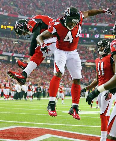 Atlanta Falcons quarterback Matt Ryan, left, celebrates with running back Jason Snelling (44) after Snelling scored a touchdown on a 5-yard pass from Ryan against the Seattle Seahawks during the third quarter of their NFC divisional playoff NFL football game, Sunday, Jan. 13, 2013, in Atlanta. The Falcons won 30-28. (AP Photo/Atlanta Journal-Constitution, Curtis Compton)  MARIETTA DAILY OUT; GWINNETT DAILY POST OUT; LOCAL TV OUT; WXIA-TV OUT; WGCL-TV OUT Photo: Curtis Compton