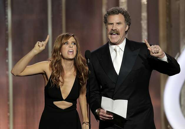 "Former ""Saturday Night Live"" alumni Kristen Wiig and Will Ferrell present the award for best actress in a comedy or musical. Photo: Paul Drinkwater, Associated Press"