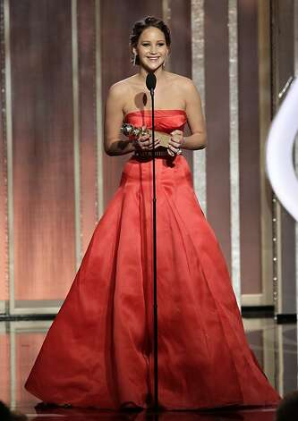 "This image released by NBC shows actress Jennifer Lawrence with her award for best actress in a motion picture comedy or musical for her role in ""Silver Linings Playbook"" during the 70th Annual Golden Globe Awards at the Beverly Hilton Hotel on Jan. 13, 2013, in Beverly Hills, Calif. (AP Photo/NBC, Paul Drinkwater) Photo: Paul Drinkwater, Associated Press"