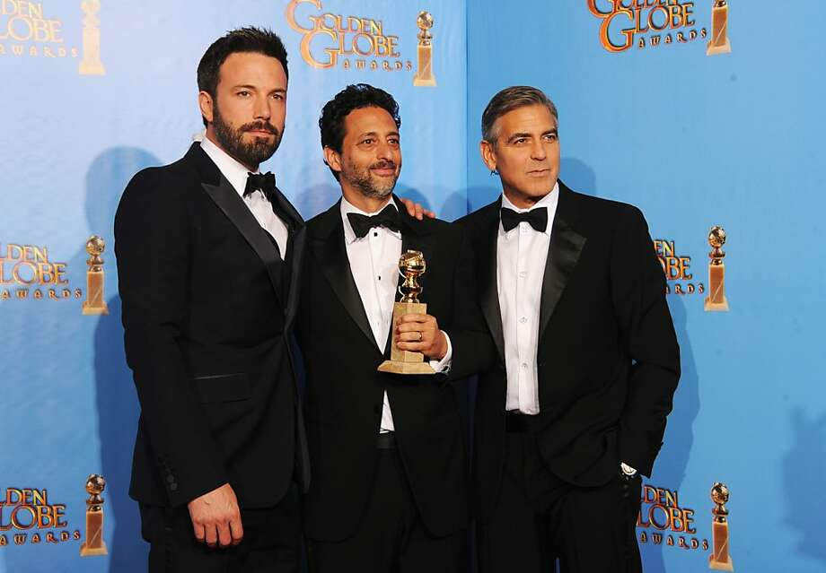 """Argo"" actor-director Ben Affleck (left) and producers Grant Heslov and George Clooney win. Photo: Kevin Winter, Getty Images"