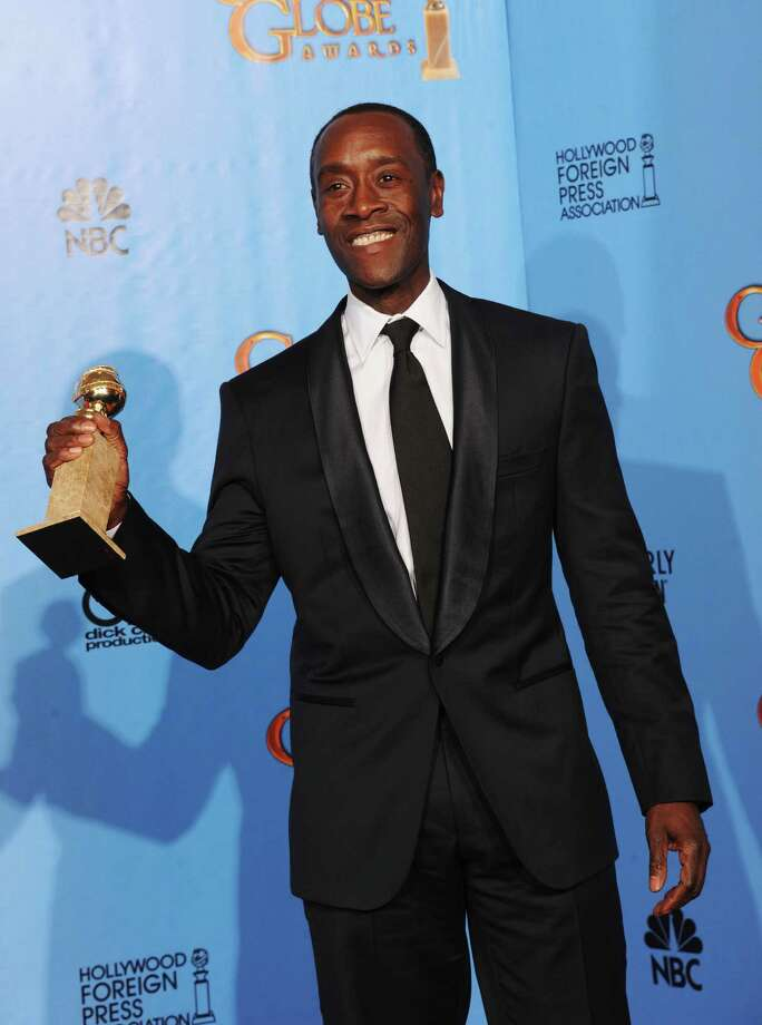 "Actor Don Cheadle, winner of Best Actor in a Television Series (Musical or Comedy) for ""House of Lies,"" poses in the press room during the 70th Annual Golden Globe Awards held at The Beverly Hilton Hotel on January 13, 2013 in Beverly Hills, California. Photo: Kevin Winter, Getty / 2013 Getty Images"