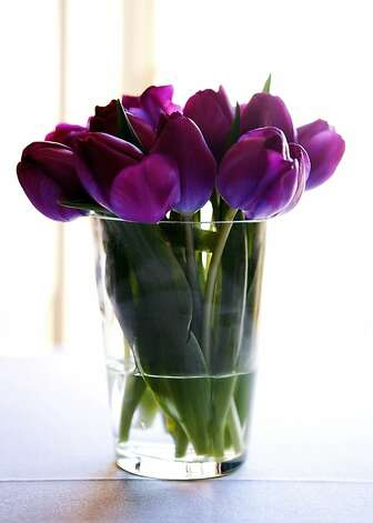 Purple tulips add to the color scheme. Photo: Billy Winters, Www.billywinters.com/weddings