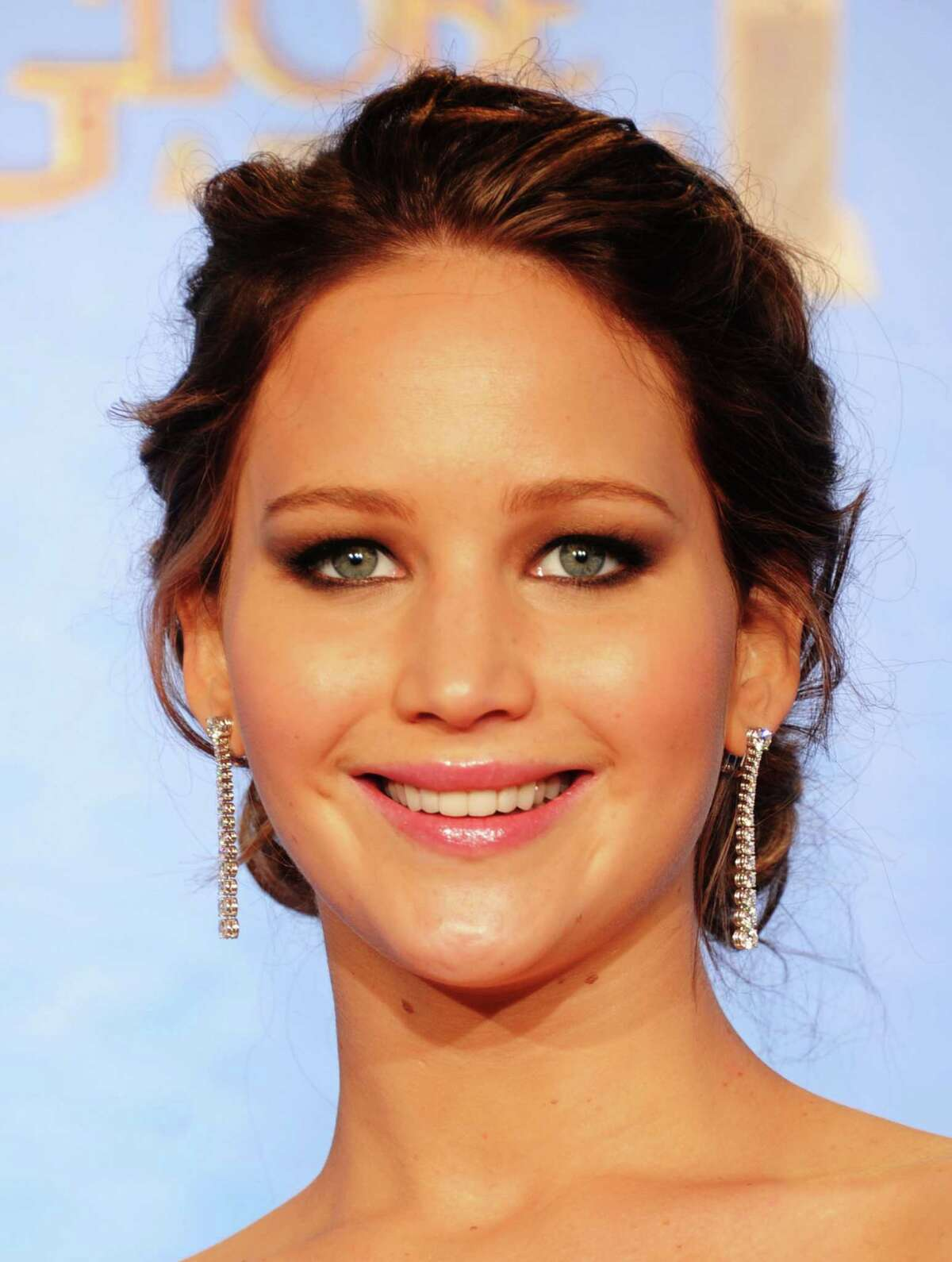 Actress Jennifer Lawrence, winner of Best Performance by an Actress in a Motion Picture (Musical or Comedy) for