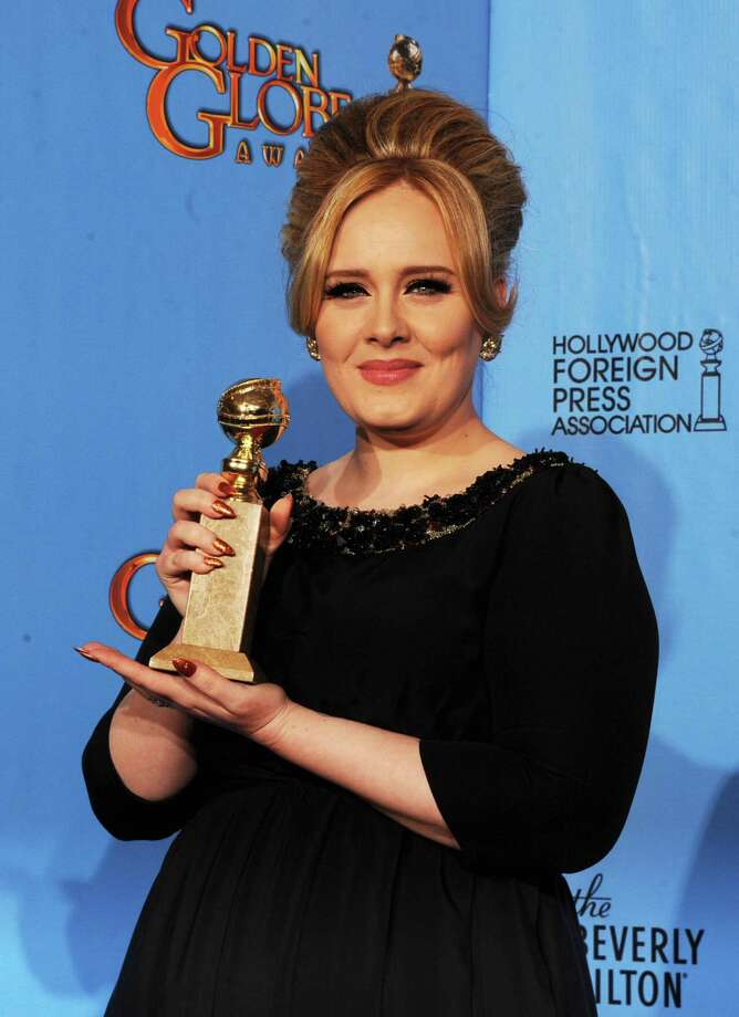 "Singer Adele, winner of Best Original Song for a Motion Picture for ""Skyfall"" from ""Skyfall,"" poses in the press room during the 70th Annual Golden Globe Awards held at The Beverly Hilton Hotel on January 13, 2013 in Beverly Hills, California. Photo: Kevin Winter, Getty / 2013 Getty Images"