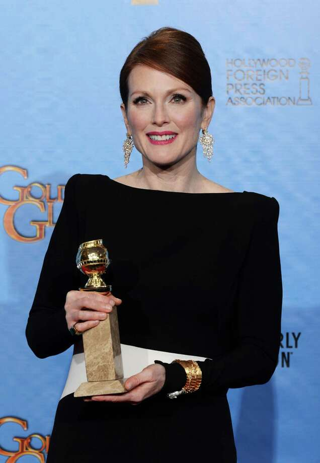 Actress Julianne Moore poses in the press room during the 70th Annual Golden Globe Awards held at The Beverly Hilton Hotel on January 13, 2013 in Beverly Hills, California. Photo: Kevin Winter, Getty / 2013 Getty Images